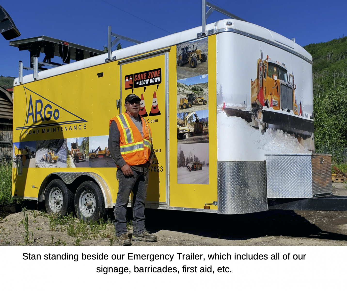 Stan standing beside our Emergency Trailer, which includes all of our signage, barricades, first aid, etc.