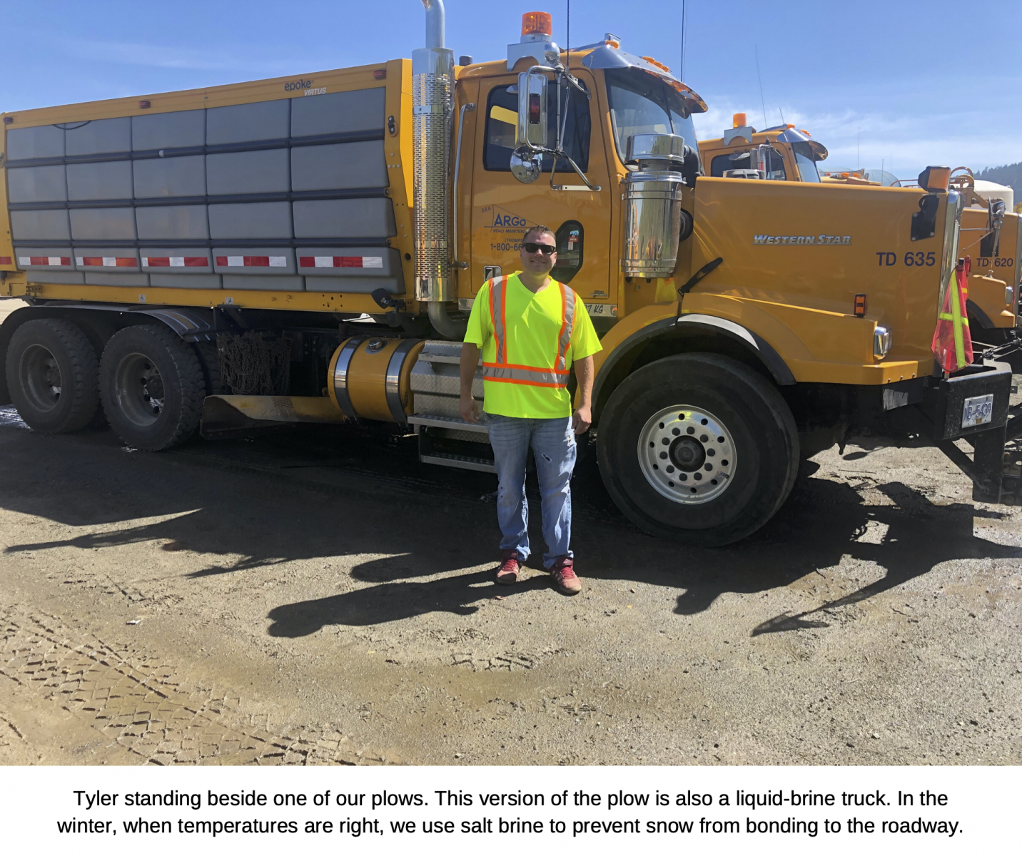 Tyler standing beside one of our plows. This version of the plow is also a liquid brine truck. In the winter, when temperatures are right, we use salt brine to prevent snow from bonding to the roadway.